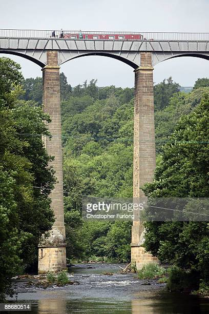 A narrow boat navigates the Pontcysyllte Aqueduct which has been nominated as a World Heritage Site on June 25 2009 in Pontcysyllte United Kingdom...