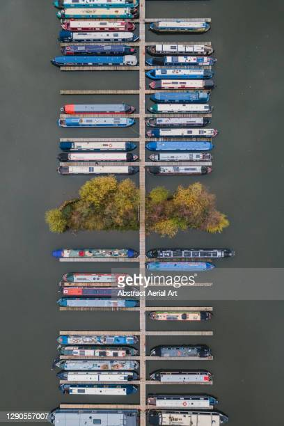 narrow boats moored in mercia marina seen from above, derbyshire, england, united kingdom - canal stock pictures, royalty-free photos & images