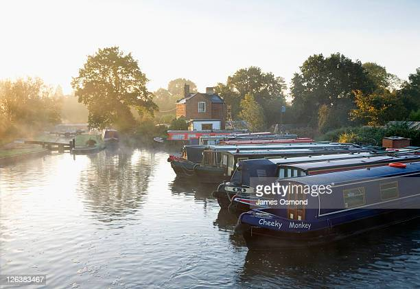 Narrow boats moored on the Stratford-upon-Avon Canal at Lapworth, Warwickshire.