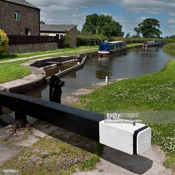 narrow boats on canal - macclesfield stock photos and pictures