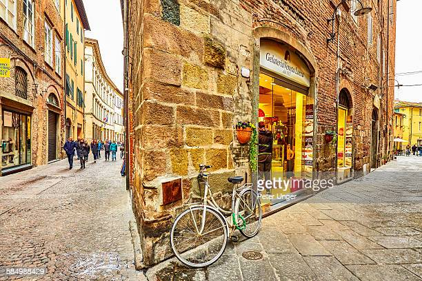 Narrow building in street of Lucca, Italy