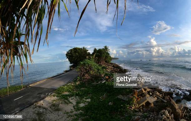 A narrow causeway at the north end of the island with the lagoon and ocean on August 15 2018 in Funafuti Tuvalu The small South Pacific island nation...