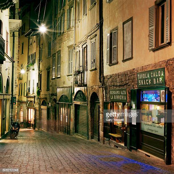 Narrow cobbled street in Bergamo at night