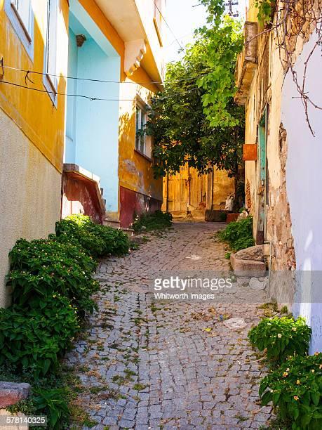 narrow cobbled village lane bergama turkey - bergama stock pictures, royalty-free photos & images
