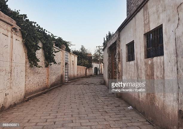 Narrow Cobblestone Street Amidst Old Houses In Town