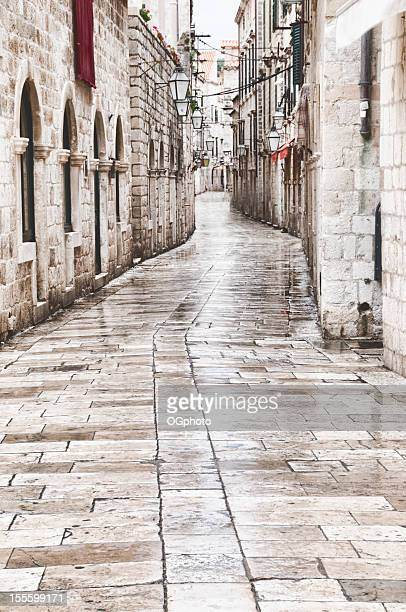 narrow cobblestone  street in ancient town - ogphoto stock pictures, royalty-free photos & images