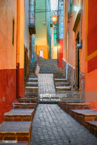 narrow colorful alley in guanajuato city, mexico - guanajuato stock pictures, royalty-free photos & images