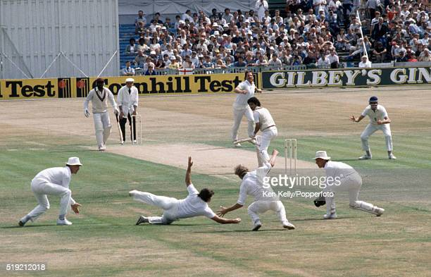 A narrow escape for West Indies batsman Larry Gomes as the ball passes between the England slip fielders Allan Lamb and David Gower off the bowling...