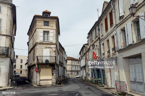 narrow house in the streets of angouleme, france - angouleme stock photos and pictures