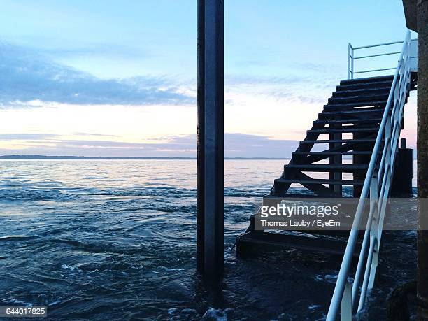 Narrow Ladder With Calm Sea Against The Sky