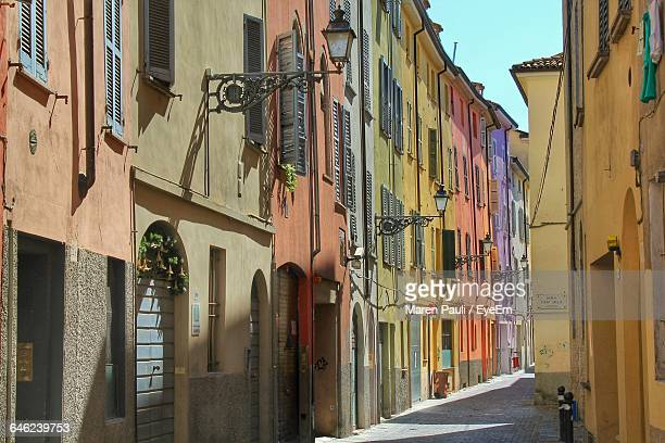 narrow pathway along built structures - parma stock photos and pictures