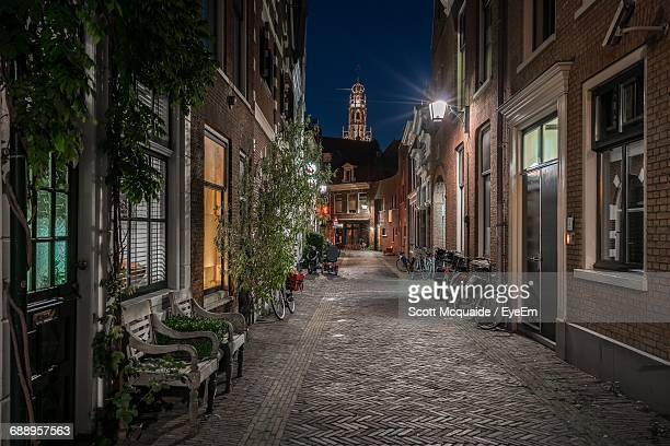 narrow pathway along built structures - haarlem stock photos and pictures
