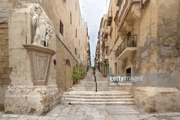 A narrow pedestrian street in Valletta, Malta