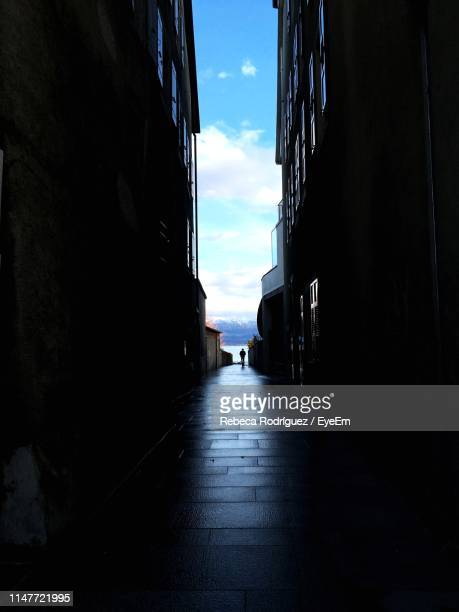 narrow street amidst buildings against sky - narrow stock pictures, royalty-free photos & images