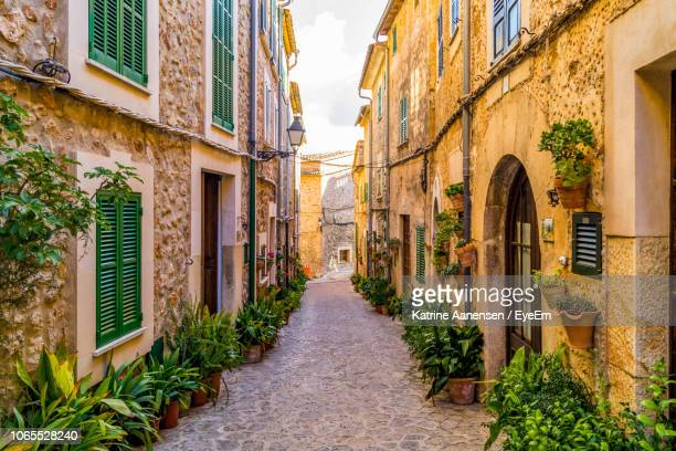 narrow street amidst buildings in city - majorca stock pictures, royalty-free photos & images