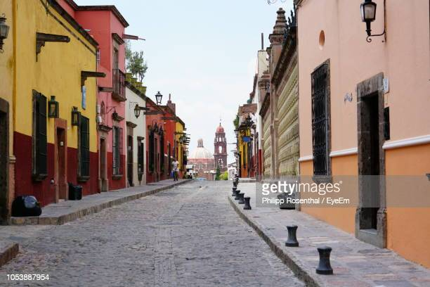 narrow street amidst buildings in town - mexico city stock pictures, royalty-free photos & images