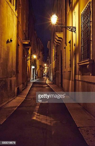 Narrow street at dusk, Verona, Italy,
