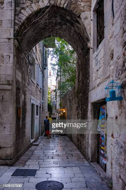 narrow street between houses in diocletian palace, split, croatia - between stock pictures, royalty-free photos & images