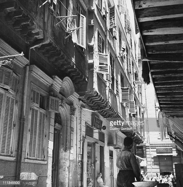 A narrow street in Alexandria Egypt circa 1925