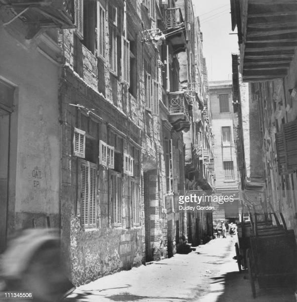 A narrow street in Alexandria Egypt circa 1925
