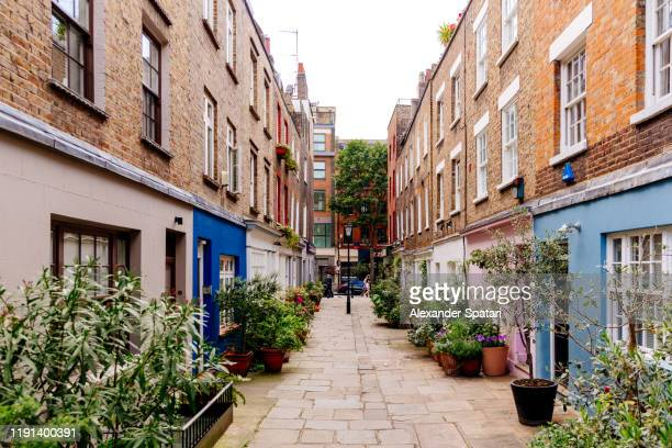 narrow street in fitzrovia district, london, england, uk - english culture stock pictures, royalty-free photos & images