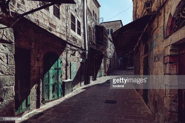 narrow street in jerusalem old city - jerusalem stock pictures, royalty-free photos & images