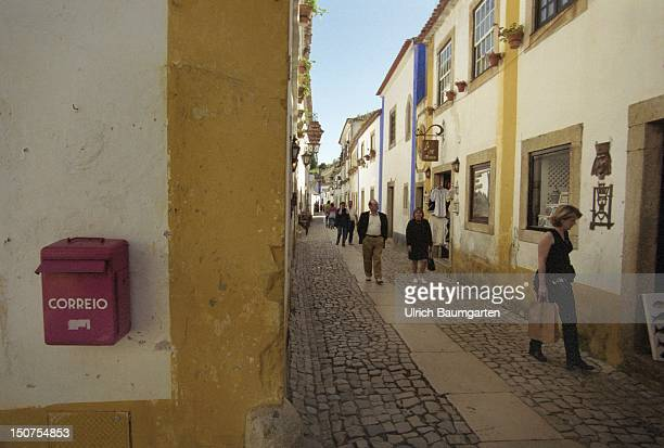 Narrow street in Obidos, a small medieval town in Portugal.