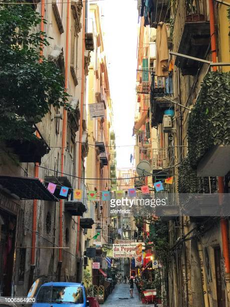 narrow street in old naples, italy (napoli) - naples italy stock photos and pictures