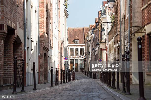 narrow street in the center of lille - france lille stock pictures, royalty-free photos & images