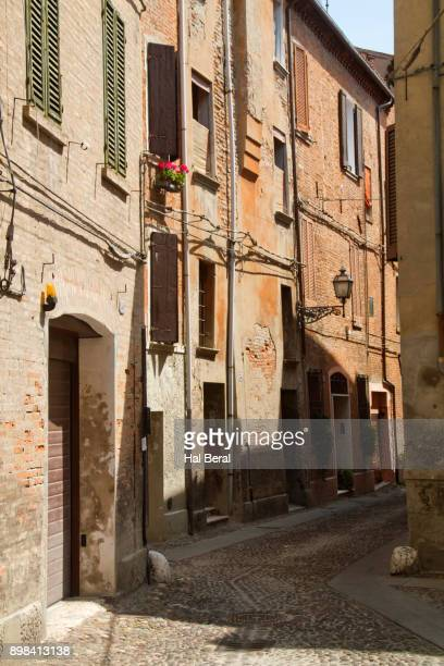 narrow street in the old jewish getto of ferrara - ferrara stock pictures, royalty-free photos & images