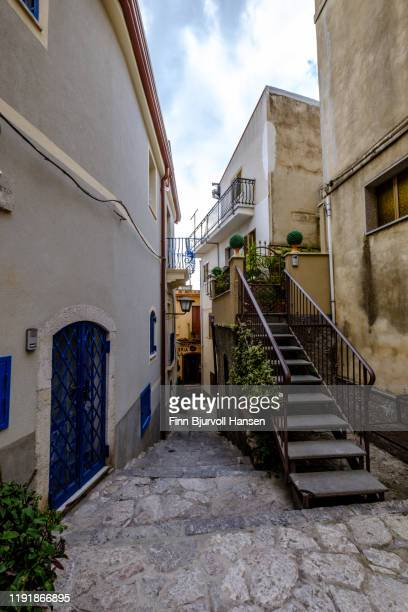 narrow street in the town of castelmola taormina in sicily italy - finn bjurvoll stock photos and pictures