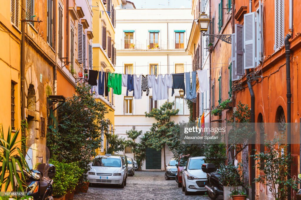 Narrow street in Trastevere with clean clothes on a washing line after laundry, Rome, Italy : Stock Photo