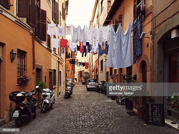 Narrow street in Trastevere with drying clothes