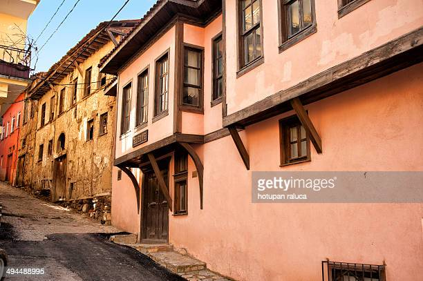 CONTENT] Narrow street with old ottoman houses in Umurbey village