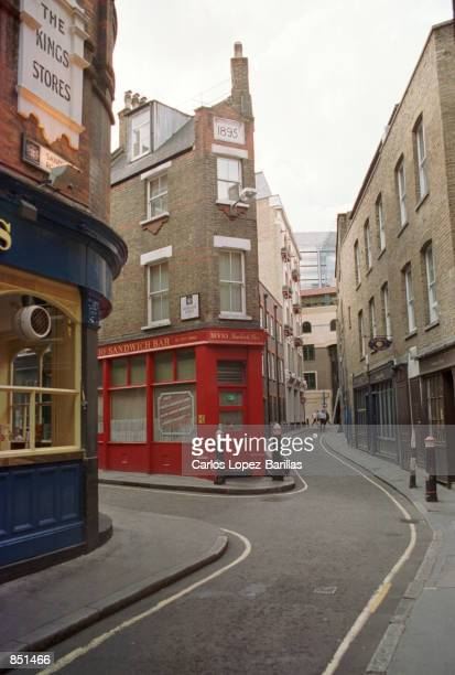 Narrow streets curve in front of old buildings August 2 2000 near the area of Aldgate East London United Kingdom This is where Jack the Ripper...