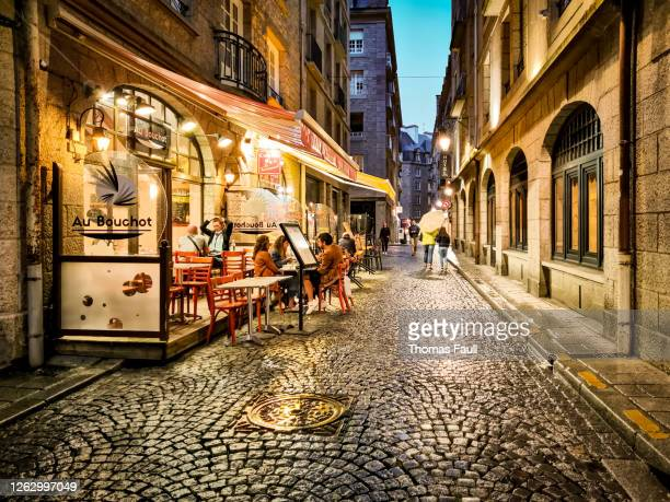 narrow streets of st malo at night after rain - ille et vilaine stock pictures, royalty-free photos & images