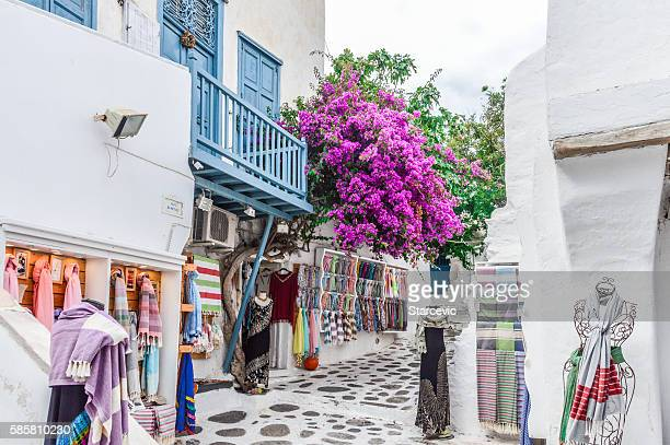 Narrow winding streets with whitewashed buildings and blue - Mykonos