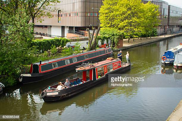 narrowboating kings cross. - tiller stock photos and pictures
