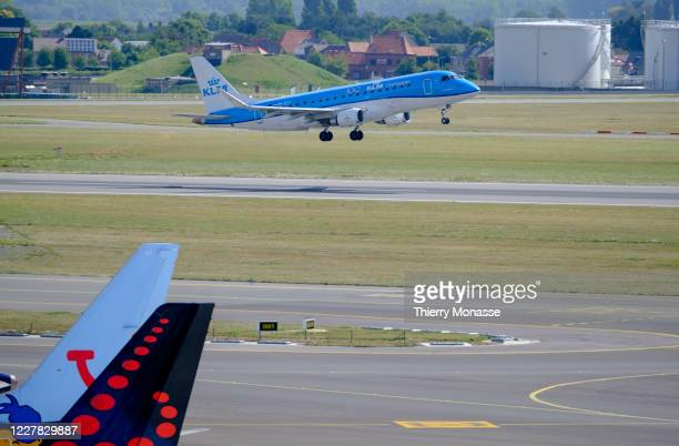 Narrow-body short- to medium-range twin-engine jet airliners Embraer E 175 from KLM Royal Dutch Airlines is taking off in the Brussels airport on...