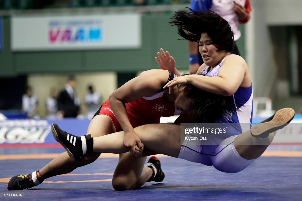 Naruha Matsuyuki (L) competes against Mei Shindo in the Women's 72kg final on day one of the All Japan Wrestling Invitational Championships at Komazawa Gymnasium on June 14, 2018 in Tokyo, Japan.