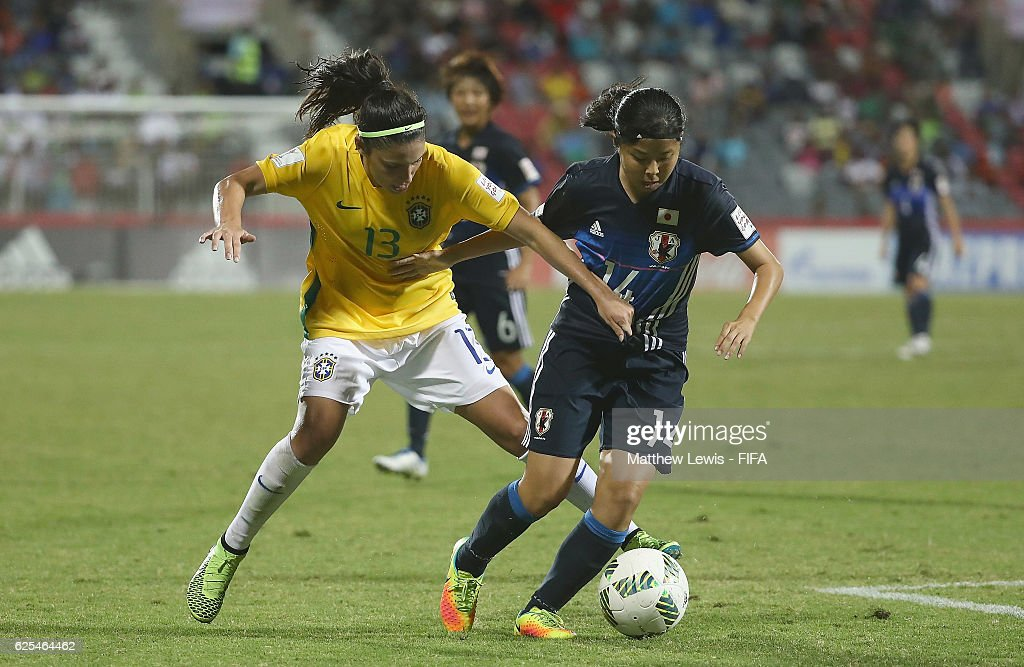 Narumi Miura of Japan holds off Bruna of Brazil during the FIFA U-20 Women's World Cup Papua New Guinea 2016 Quarter Final match between Japan and Brazil at the National Footbal Stadium on November 24, 2016 in Port Moresby, Papua New Guinea.