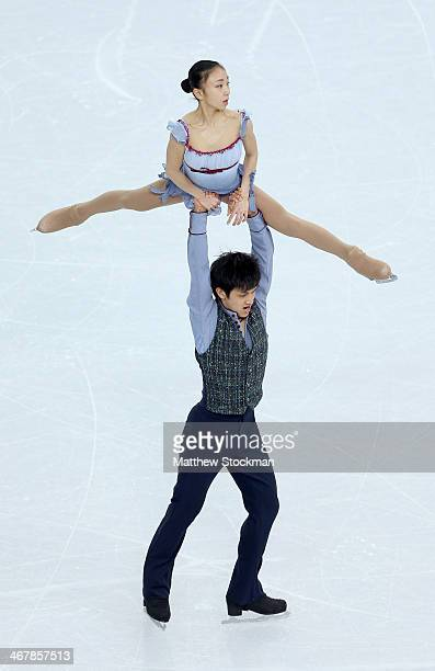Narumi Takahashi and Kihara Ryuichi of Japan compete in the Figure Skating Team Pairs Free Skating during day one of the Sochi 2014 Winter Olympics...