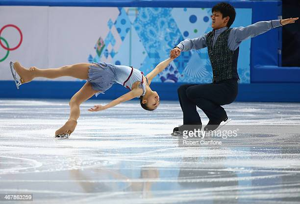 Narumi Takahashi and Kihara Ryuichi of Japan compete in the Figure Skating Team Pairs Free Skating Program during day one of the Sochi 2014 Winter...