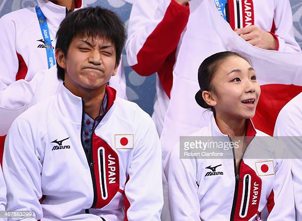 Narumi Takahashi and Kihara Ryuichi of Japan look on after competing in the Figure Skating Team Pairs Free Skating Program during day one of the...