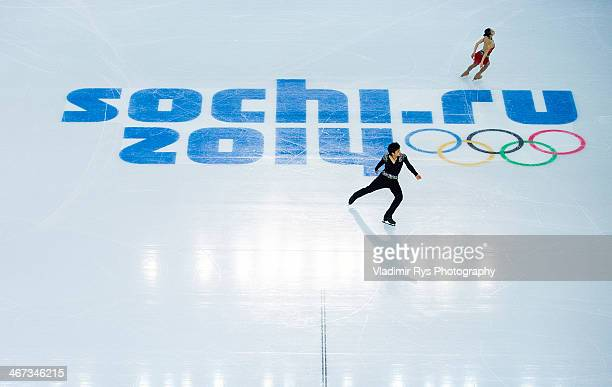 Narumi Takahashi and Ryuichi Kihara of Japan compete during the Sochi 2014 Winter Olympics at Iceberg Skating Palace on February 6 2014 in Sochi...