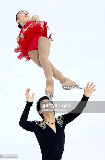 Narumi Takahashi and Ryuichi Kihara of Japan compete in the Figure Skating Pairs Short Program during the Sochi 2014 Winter Olympics at Iceberg...