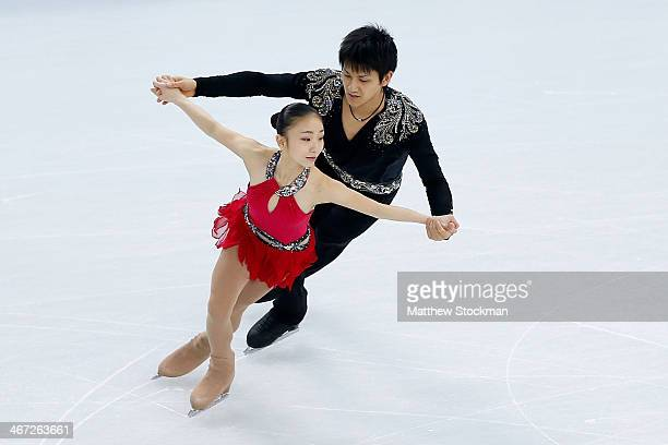 Narumi Takahashi and Ryuichi Kihara of Japan compete in the Figure Skating Pairs Short Program during the Sochi 2014 Winter Olympics at Iceberg...