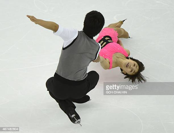 Narumi Takahashi and Ryuichi Kihara of japan compete in the pairs short program during the 2015 ISU World Figure Skating Championships at the...
