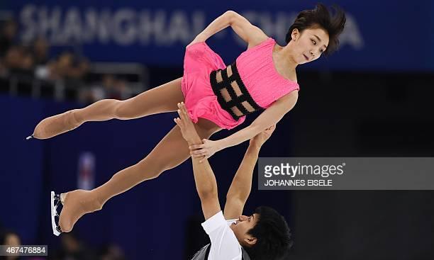 Narumi Takahashi and Ryuichi Kihara of Japan perform during the pairs short program of the 2015 ISU World Figure Skating Championships at Shanghai...