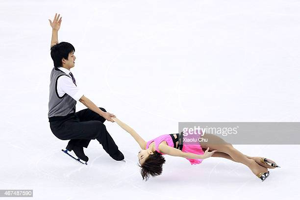 Narumi Takahashi and Ryuichi Kihara of Japan perform during the Pairs Short Program on day one of the 2015 ISU World Figure Skating Championships at...